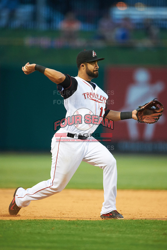Arkansas Travelers third baseman Brian Hernandez (12) throws to first after fielding a ground ball during a game against the Corpus Christi Hooks on May 29, 2015 at Dickey-Stephens Park in Little Rock, Arkansas.  Corpus Christi defeated Arkansas 4-0 in a rain shortened game.  (Mike Janes/Four Seam Images)