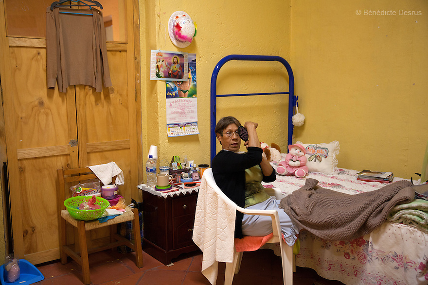 A resident of Casa Xochiquetzal, in her bedroom at the shelter in Mexico City, Mexico on January 6, 2015. Casa Xochiquetzal is a shelter for elderly sex workers in Mexico City. It gives the women refuge, food, health services and a space to learn about their human rights, as well as courses to help them rediscover their self-confidence and deal with traumatic aspects of their lives. Casa Xochiquetzal provides a space to age with dignity for a group of vulnerable women who are often invisible to society at large. It is the only such shelter existing in Latin America. Photo by Bénédicte Desrus