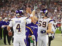 Dec 6, 2009; Glendale, AZ, USA; Minnesota Vikings defensive end (69) Jared Allen high fives quarterback (4) Brett Favre after a touchdown against the Arizona Cardinals at University of Phoenix Stadium. The Cardinals defeated the Vikings 30-17. Mandatory Credit: Mark J. Rebilas-