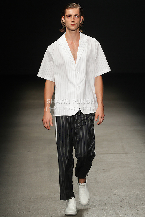 Model walks runway in an outfit from the Ordinary People Spring Summer 2016 Active Maestro collection by Jang hyeong cheol for the Concept Korea Spring Summer 2016 fashion show, duringn New York Fashion Week Men, Spring Summer 2016.