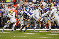 Kansas State quarterback Jake Waters (15) is tackled by UCLA defenders during second half of Alamo Bowl, Friday, January 02, 2015 in San Antonio, Tex. UCLA defeated Kansas State 40-35. (Mo Khursheed/TFV Media via AP Images)