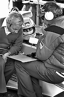 ANDERSTORP, SE - JUNE 13: Jochen Mass of Germany, driver of the McLaren M23 9/Ford Cosworth, speaks with Teddy Mayer, left, and engineer Gordon Coppuck, right, during practice for the Swedish Grand Prix near Anderstorp, Sweden, on June 13, 1976.