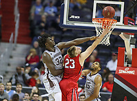 Washington, DC - March 10, 2018: Davidson Wildcats forward Peyton Aldridge (23) gets fouled by St. Bonaventure Bonnies center Amadi Ikpeze (32) during the Atlantic 10 semi final game between St. Bonaventure and Davidson at  Capital One Arena in Washington, DC.   (Photo by Elliott Brown/Media Images International)
