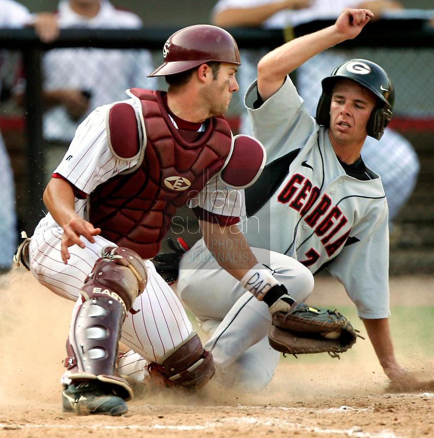Georgia's Matthew Dunn slides safely past South Carolina catcher Trent Kline on a single by Josh Morris in the seventh inning against South Carolina in Game 2 of the NCAA Athens Super Regional on Sunday, June 11, 2006.  Georgia won the game 11-5.