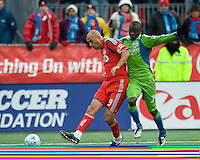 Jhon Kennedy Hurtado (right)  of the Seattle Sounders FC and Danny Dichio (9) of Toronto FC in MLS action at BMO Field on April 4, 2009.Seattle won 2-0.