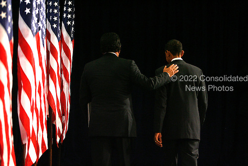 Chicago, IL - December 3, 2008 -- United States Secretary of Commerce designee and New Mexico Governor Bill Richardson (L) pats United States President-elect Barack Obama on the back as they leave a news conference in Chicago on December 3, 2008. .Credit: Brian Kersey - Pool via CNP