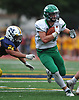 Kevin Wilson #34 of Farmingdale, right, finds an opening and rushes for a gain during a Nassau County Conference I varsity football game against host Massapequa High School on Saturday, Sept. 22, 2018. He ran for three touchdowns. Farmingdale won by a score of 41-27.
