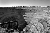 Mirny, Yakutia, Russia  .May-June 1997.The Russian diamond mine, MIR is the largest man-made hole in the world. The impoverished city of Mirny lies just behind the creator. A landslide blocks trucks from coming up with the precious diamond filled earth in the photo...