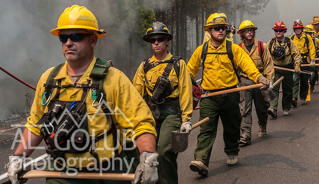 US Forest Service crew hike down Harden Flat Road to support structors during fire.