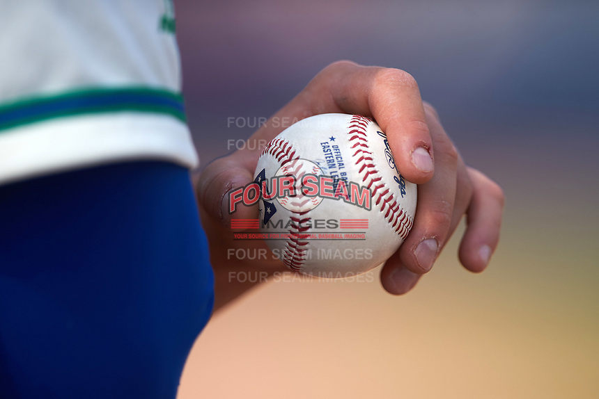 Hartford Yard Goats player holds an Eastern League baseball during the first game of a doubleheader against the Trenton Thunder on June 1, 2016 at Sen. Thomas J. Dodd Memorial Stadium in Norwich, Connecticut.  Trenton defeated Hartford 4-2.  (Mike Janes/Four Seam Images)