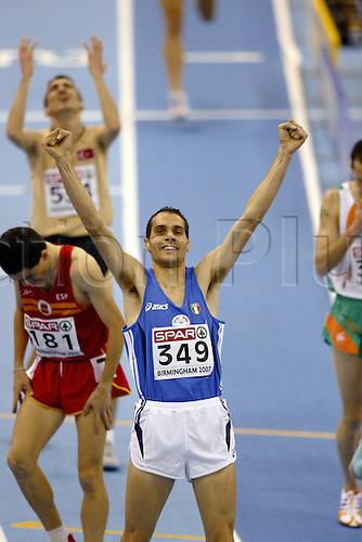 3 March 2007: Italian runner Cosimo Caliandro (ITA) celebrates victory in the Men's 3000m Final at the European Indoor Athletics Championships held at the National Indoor Arena, Birmingham. Photo: Neil Tingle/Actionplus...070303 athletics celebration joy