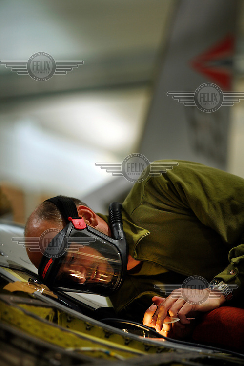 Ground crew working on a Lockheed Martin F-16 Fighting Falcon from Norwegian Air Force 338 squadron. BOLD AVENGER 2007 (BAR 07), a NATO  air exercise at Ørland Main Air Station, Norway. BAR 07 involved air forces from 13 NATO member nations: Belgium, Canada, the Czech Republic, France, Germany, Greece, Norway, Poland, Romania, Spain, Turkey, the United Kingdom and the United States of America. The exercise was designed to provide training for units in tactical air operations, involving over 100 aircraft, including combat, tanker and airborne early warning aircraft and about 1,450 personnel.