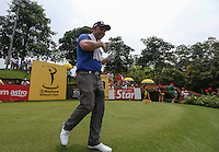 Big smiles from Andy Sullivan (ENG) as he chases Lee Westwood (ENG) during the Final Round of the 2014 Maybank Malaysian Open at the Kuala Lumpur Golf & Country Club, Kuala Lumpur, Malaysia. Picture:  David Lloyd / www.golffile.ie