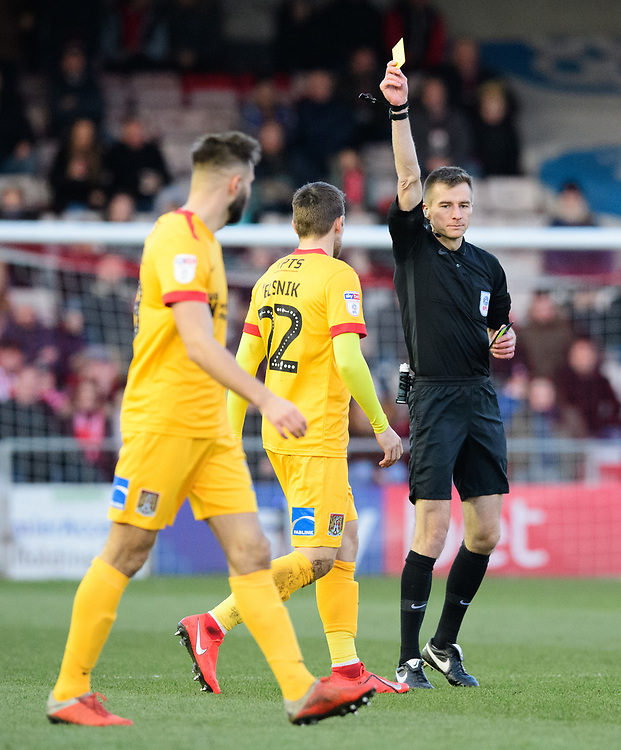 Northampton Town's Timi Elsnik is shown a yellow card by referee Michael Salisbury<br /> <br /> Photographer Chris Vaughan/CameraSport<br /> <br /> The EFL Sky Bet League Two - Lincoln City v Northampton Town - Saturday 9th February 2019 - Sincil Bank - Lincoln<br /> <br /> World Copyright &copy; 2019 CameraSport. All rights reserved. 43 Linden Ave. Countesthorpe. Leicester. England. LE8 5PG - Tel: +44 (0) 116 277 4147 - admin@camerasport.com - www.camerasport.com