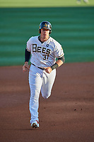 Justin Bour (37) of the Salt Lake Bees circles the bases after hitting a home run against the El Paso Chihuahuas at Smith's Ballpark on August 17, 2019 in Salt Lake City, Utah. The Bees defeated the Chihuahuas 5-4. (Stephen Smith/Four Seam Images)