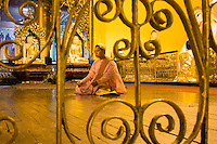 Nun worshiping at the Shwedagon pagoda, Yangon, Myanmar
