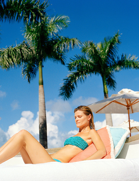 Woman sunbathing , Turks and Caicos