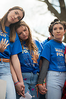 "NWA Democrat-Gazette/CHARLIE KAIJO <br /> Madelyn McFarlane, 16, of Bentonville High school (from left), Rebecca Ellis, 16, of Bentonville High School and Grayson Gomulka, 15, of Haas Hall join attendees for a moment of silence during the ""March For Our Lives"" rally, Saturday, March 24, 2018 at the Bentonville Square in Bentonville. <br /> <br /> ""March For Our Lives"" is a march against gun violence. ""[We're] just a group of kids who got together one day and wanted to make a change,"" said Taylor Gibson, 16, a student at Bentonville West High School. She is one of nine students from area high schools including Bentonville West, Bentonville High, Gravette and Haas Hall who organized the rally. The rally is in solidarity with more than 800 protests around the world according to ""March For Our Lives"" organizers"