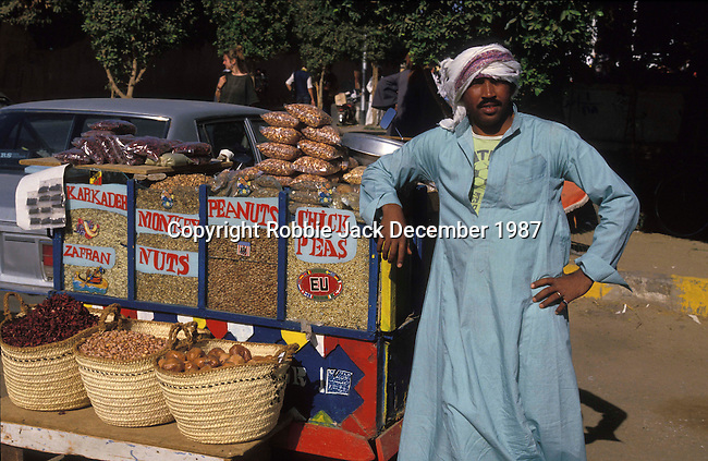 Street vendor in Luxor.The town of Luxor occupies the eastern part of a great city of antiquity which the ancient Egytians called Waset and the Greeks named Thebes.