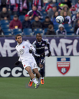 DC United defender Chris Korb (22) clears the ball as New England Revolution forward Sainey Nyassi (17) closes. In a Major League Soccer (MLS) match, the New England Revolution defeated DC United, 2-1, at Gillette Stadium on March 26, 2011.