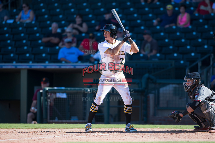 Surprise Saguaros shortstop Cole Tucker (2), of the Pittsburgh Pirates organization, at bat in front of catcher Daulton Varsho (8) during an Arizona Fall League game against the Salt River Rafters on October 9, 2018 at Surprise Stadium in Surprise, Arizona. Salt River defeated Surprise 10-8. (Zachary Lucy/Four Seam Images)