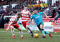Lewis Coyle of Fleetwood Town runs past Alfie Beestin of Doncaster Rovers during the Sky Bet League 1 match between Doncaster Rovers and Fleetwood Town at the Keepmoat Stadium, Doncaster, England on 17 February 2018. Photo by Leila Coker / PRiME Media Images.