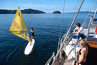 Sailing and Windsurfing in the Gulf Islands, British Columbia, Canada - Model Released Woman on Surfboard)