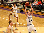 SIOUX FALLS, SD - NOVEMBER 25: Drew Guebert #23 from the University of Sioux Falls takes the ball to the basket against Carter Kirk #35 from Southwest Minnesota State University during their game Saturday night at the Stewart Center in Sioux Falls. (Photo by Dave Eggen/Inertia)