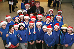 Christmas Carol Singing with Mell National School Students and Mattie Slattery...Photo NEWSFILE/Jenny Matthews.(Photo credit should read Jenny Matthews/NEWSFILE)....This Picture has been sent you under the condtions enclosed by:.Newsfile Ltd..The Studio,.Millmount Abbey,.Drogheda,.Co Meath..Ireland..Tel: +353(0)41-9871240.Fax: +353(0)41-9871260.GSM: +353(0)86-2500958.email: pictures@newsfile.ie.www.newsfile.ie.FTP: 193.120.102.198.