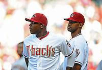 Apr. 6, 2012; Phoenix, AZ, USA; Arizona Diamondbacks outfielder Justin Upton (left) and Chris Young prior to the game against the San Francisco Giants during opening day at Chase Field.  The Diamondbacks defeated the Giants 5-4. Mandatory Credit: Mark J. Rebilas-