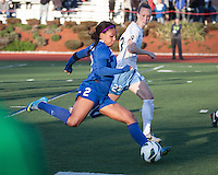 Boston Breakers forward Sydney Leroux (2) kicks a cross with Chicago Red Stars defender Michelle Wenino (23) in pursuit.  In a National Women's Soccer League Elite (NWSL) match, the Boston Breakers defeated  Chicago Red Stars 4-1, at the Dilboy Stadium on May 4, 2013.
