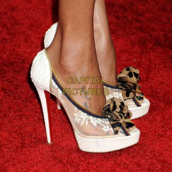 ZOE SALDANA's shoes .15th Annual Critics' Choice Movie Awards - Arrivals held at the Hollywood Palladium, Hollywood, California, USA, 15th January 2010..detail feet white platform high heels lace tattoo peep toe leopard print fabric christian louboutin .CAP/ADM/BP.©Byron Purvis/Admedia/Capital Pictures