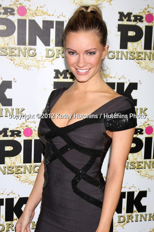 "LOS ANGELES - OCT 11:  Caitlin O'Connor arrives at the ""Mr. Pink"" Energy Drink Launch at Beverly Wilshire Hotel on October 11, 2012 in Beverly Hills, CA"