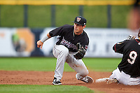 Wisconsin Timber Rattlers shortstop Blake Allemand (6) waits for a throw as Ryan Bottger (9) slides in during the first game of a doubleheader against the Quad Cities River Bandits on August 19, 2015 at Modern Woodmen Park in Davenport, Iowa.  Quad Cities defeated Wisconsin 3-2.  (Mike Janes/Four Seam Images)