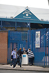 Supporters buying matchday programmes before Sheffield Wednesday take on Peterborough United in a Coca-Cola Championship match at Hillsborough Stadium, Sheffield. The home side won by 2 goals to 1 giving Alan Irvine his third straight win since taking over as Wednesday's manager.