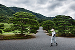 Kyoto, June 27 2013 - Gardener walking in the garden of Shugakuin Imperial villa