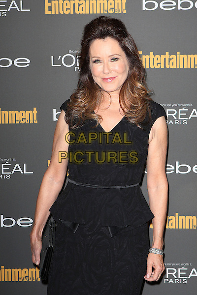 Mary McDonnell<br /> 2013 Entertainment Weekly Pre-Emmy Party held at Fig &amp; Olive Melrose Place, West Hollywood, California, USA, <br /> 20th September 2013.<br /> half length black dress peplum <br /> CAP/ADM/MPI<br /> &copy;MediaPunch Inc./AdMedia/Capital Pictures