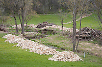 Materials for restoration work are stockpiled along a section of creek in Wisconsin's Driftless Area near Viroqua.