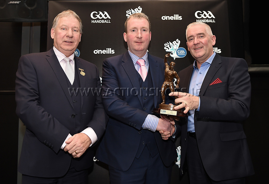 03/02/2018; GAA Handball All-Stars Awards 2018; Croke Park, Dublin;<br /> Male player of the year award is accepted by Conor McDonnell on behalf of winner Charly Shanks with GAA Handball President Joe Masterson and Cormac Farrell, Marketing manager of O'Neills Sportswear.<br /> Photo Credit: actionshots.ie/Tommy Grealy