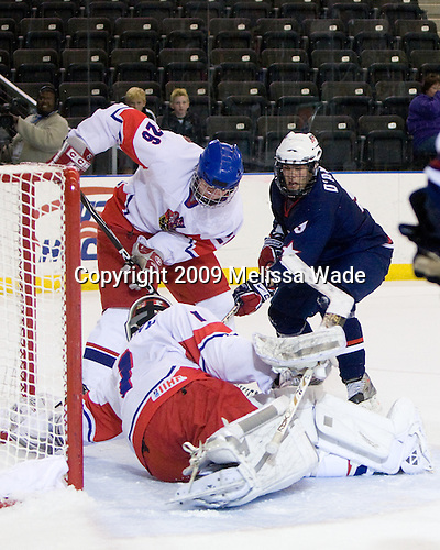 Ondrej Dolezal (Czech Republic - 26), Filip Novotny (Czech Republic - 1), Jerry D'Amigo (US - 9) - The US defeated the Czech Republic 6-2 on Thursday, April 16, 2009, at the Urban Plains Center in Fargo, North Dakota, during the 2009 World Under 18 Championship.