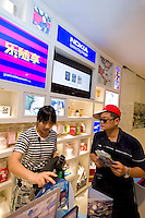 Visitors browse Nokia products in the pavilion's store in Finland's Pavilion, on Shanghai World Expo 2010 site, in Shanghai, China, on September 19, 2010. Photo by Lucas Schifres/Pictobank
