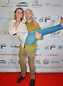 FORT LAUDERDALE, FLORIDA - NOVEMBER 09: Radha Mitchell and Ben Hackworth arrive at the 34th Annual Fort Lauderdale International Film Festival - Radha Mitchell & Justin Long Honored With Career Achievement Awards at Savor Cinema on November 09, 2019 in Fort Lauderdale, Florida. ( Photo by Johnny Louis / jlnphotography.com )