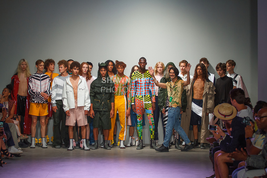 Fashion designer Nicholas P. Elliott walks with models at the close of his N-p-Elliott Spring Summer 2018 collection fashion show, in Skylight Clarkson Square on July 11, 2017; during New York Fashion Week: Men's Spring Summer 2018.