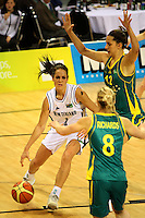Ferns forward Natalie Purcell is marked by Mariana Tolo and Samantha Richards during the International women's basketball match between NZ Tall Ferns and Australian Opals at Te Rauparaha Stadium, Porirua, Wellington, New Zealand on Monday 31 August 2009. Photo: Dave Lintott / lintottphoto.co.nz