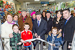 Michael Healy Rae cuts the tape to officially open Killarney Pharmacy for Padraig and Aine O'Connor (right) on Saturday