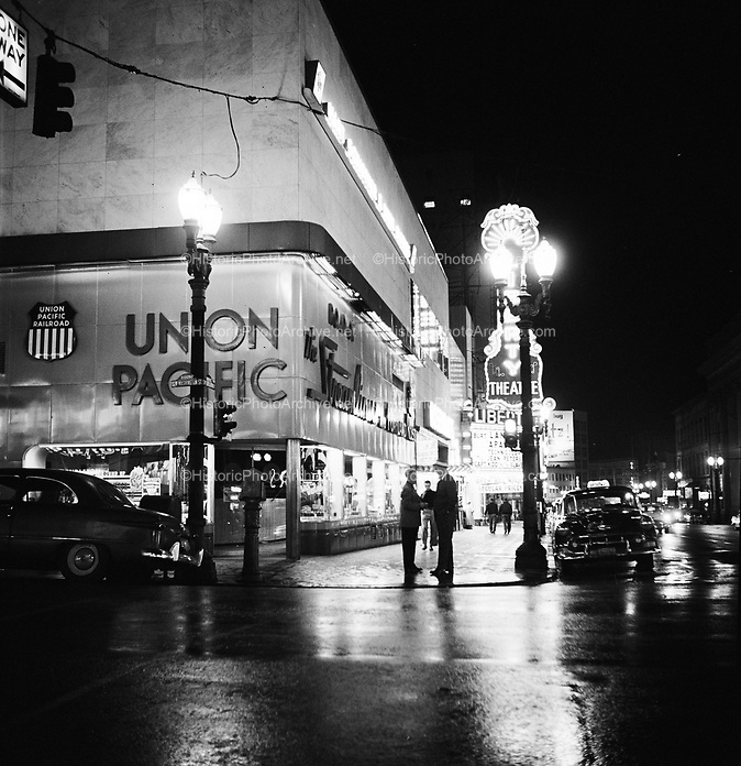 9969-540825. SW Broadway & Washington at night, August 25, 1954