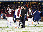 Robbie Neilson with the Hearts players after referee Bobby Madden calls a halt to the game midway through the first half