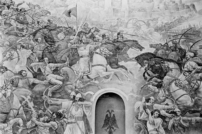 Albania. Province of Kruja. Kruja. Museum for the albanian hero Skanderbeg who fought for years against the turks (ottoman). A painting of one of his battles. George Kastrioti Skanderbeg (1405-1468), widely known as Skanderbeg, was a 15th-century Albanian lord. He was appointed as the governor of the Sanjak of Dibra by the Ottoman Turks in 1440. In 1444, he initiated and organized the League of Lezh', which proclaimed him Chief of the League of the Albanian people, and defended the region of Albania against the Ottoman Empire for more than two decades. Skanderbeg's military skills presented a major obstacle to Ottoman expansion, and he was considered by many in western Europe to be a model of Christian resistance against the Ottoman Muslims. Skanderbeg is Albania's most important national hero and a key figure of the Albanian National Awakening. The double-headed eagle is the national symbol of the Albanians and was used for heraldic purposes during the Middle Ages by a number of Albanian noble families, including the Kastrioti, whose most famous member was George Kastriot Skanderbeg. 26.09.03  © 2003 Didier Ruef