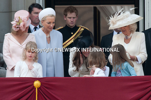 """TROOPING THE COLOUR 2011.Catherine explains to the excited girls how the view looked on her wedding day..The Duchess of Cambridge also did a quick demonstration of Laura Lopes covering her ears..Catherine, The Duchess of Cambridge at her first Trooping the Colour.The Duchess of Cambridge shared a carriage with The Duchess of Cornwall, Prince Harry and the Duke of York. Prince William accompanied his Farther Prince Charles on horse back for the first time along with Princess Anne and the Duke of Kent.The Second carriage was occupied by The Count and Countess of Wessex, Lady Louise and Princess Eugenie_Buckingham Palace, London_11/06/2011..Mandatory Photo Credit: ©Dias/Newspix International..**ALL FEES PAYABLE TO: """"NEWSPIX INTERNATIONAL""""**..PHOTO CREDIT MANDATORY!!: NEWSPIX INTERNATIONAL(Failure to credit will incur a surcharge of 100% of reproduction fees)..IMMEDIATE CONFIRMATION OF USAGE REQUIRED:.Newspix International, 31 Chinnery Hill, Bishop's Stortford, ENGLAND CM23 3PS.Tel:+441279 324672  ; Fax: +441279656877.Mobile:  0777568 1153.e-mail: info@newspixinternational.co.uk"""