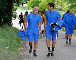 Nederland, Papendal, 1 juli 2012.Seizoen 2012-2013.Eerste training Vitesse .Fred Rutten (l.),  de nieuwe trainer-coach van Vitesse op weg naar de eerste training van Vitesse. In het midden keeperstrainer Raimond van der Gaauw